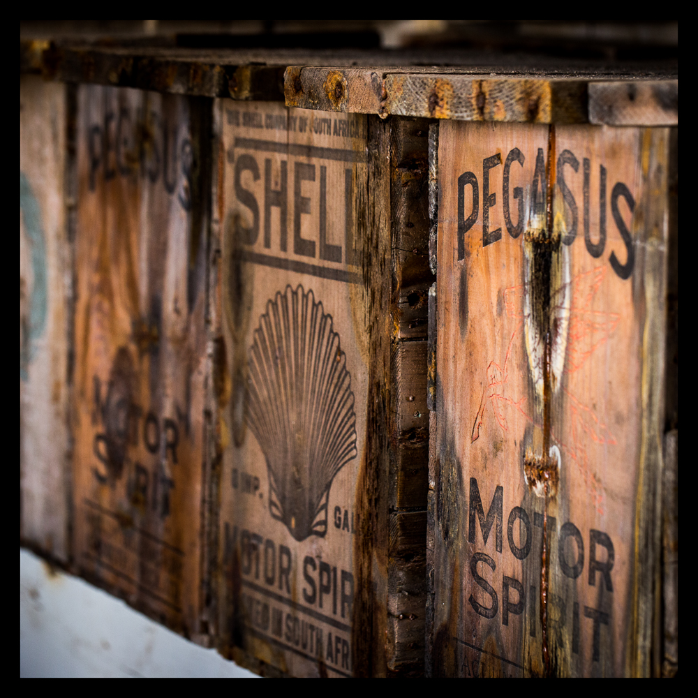 Wooden boxes used to hold petrol.