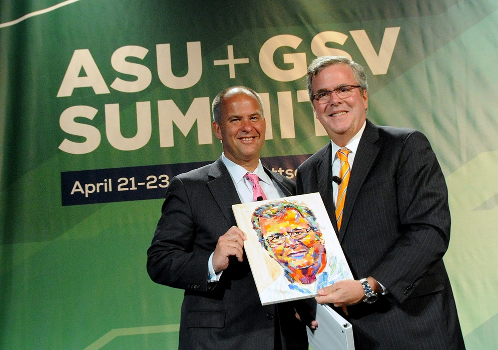 ASU + GSV Summit Jeb Bush with original vibrant painting.jpg