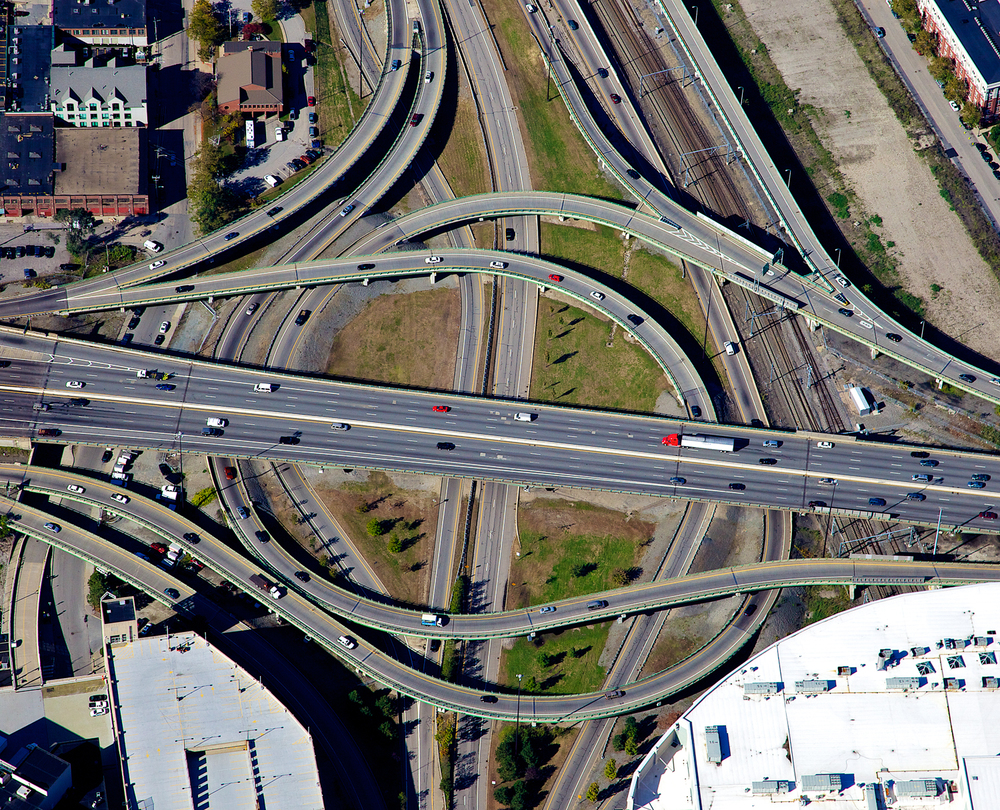 "A near vertical shot of an I-95 cloverleaf in Providence RI.  Part of a project to document the ""renovation"" of downtown Providence.  Shot from a Cessna 172, during an extremely hard bank.  Fall of 2012."