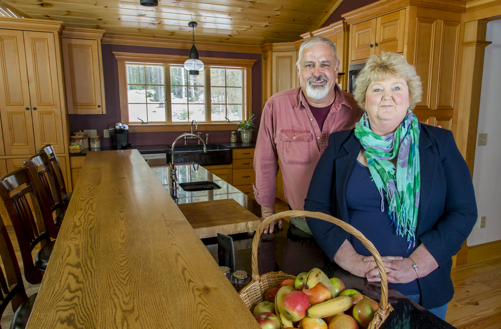 "The Thayers in their new kitchen, milled from reclaimed wood from the ""Hesper"" and the ""Luther Little""."