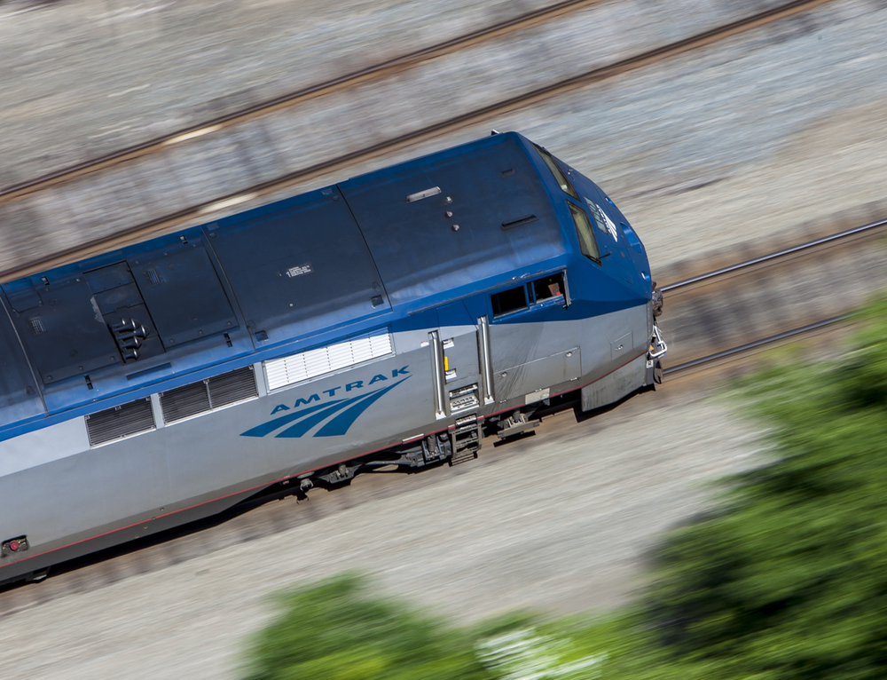 Using a ND filter to blur passing trees during an Amtrak aerial shoot.