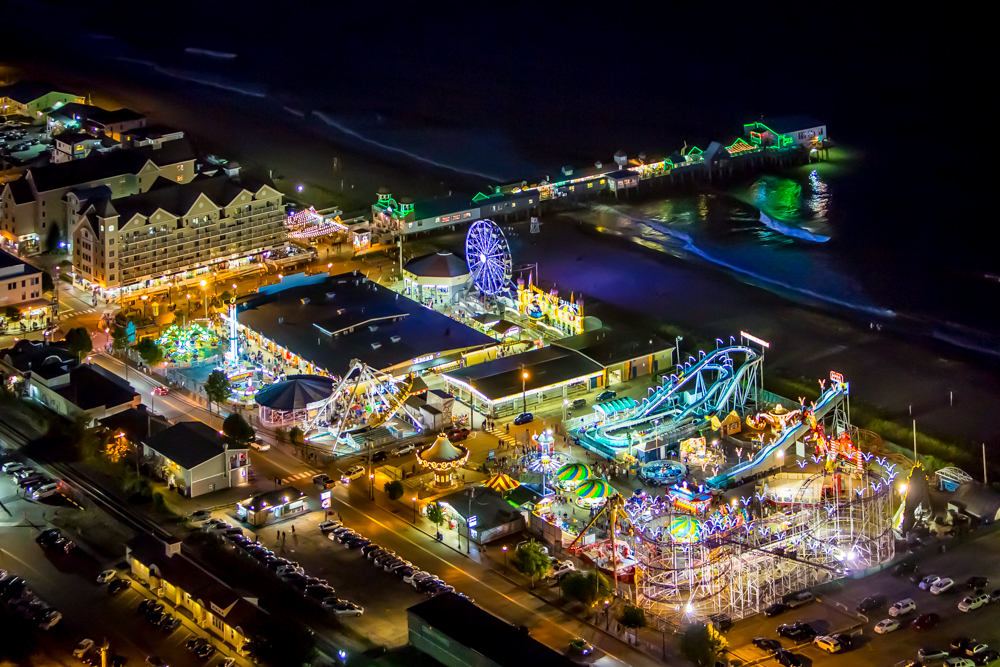A night time aerial image of Palace Playland and old orchard beach, Maine.  Shot from a helicopter, using a two axis gyro stabilizer, at 1/80th of a second.