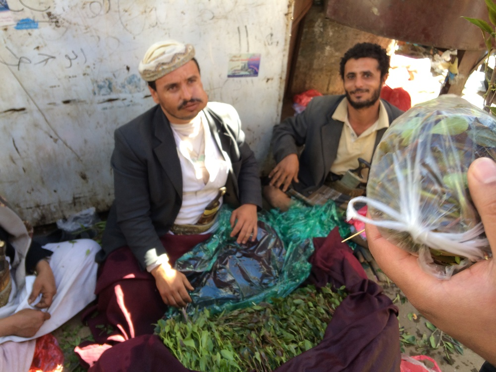 A Yemeni Qat seller shows off his wares at a souk in Sanaa. Photograph by Lucy Kafanov