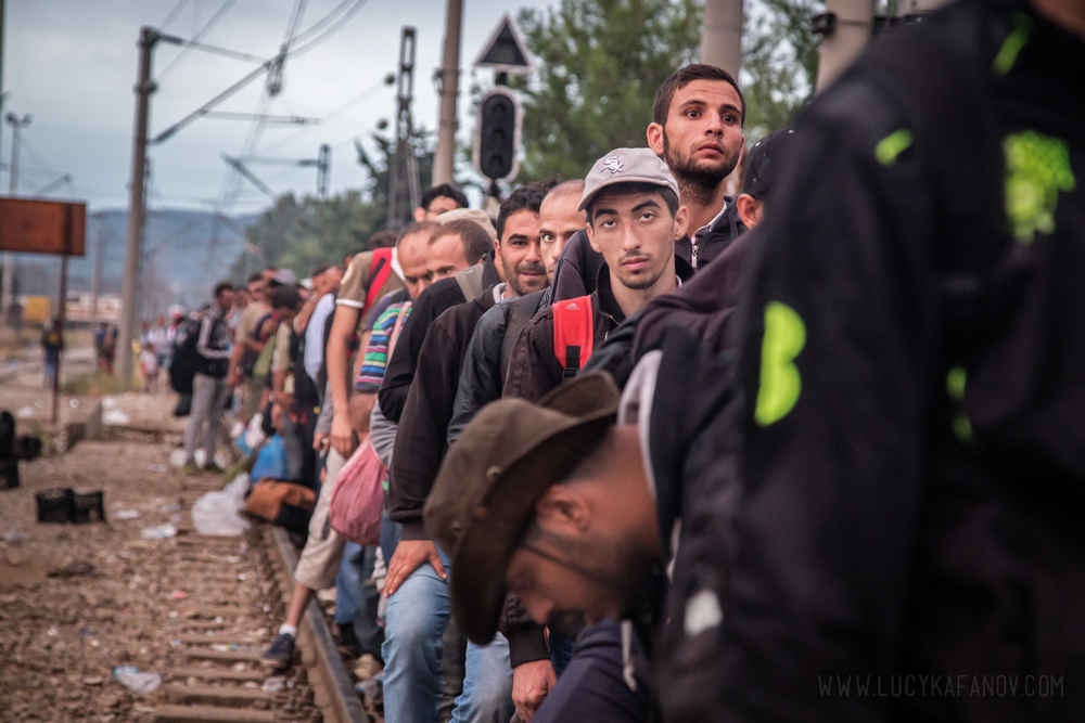 Hundreds of migrants wait on the train tracks for Macedonians to open the border crossing.