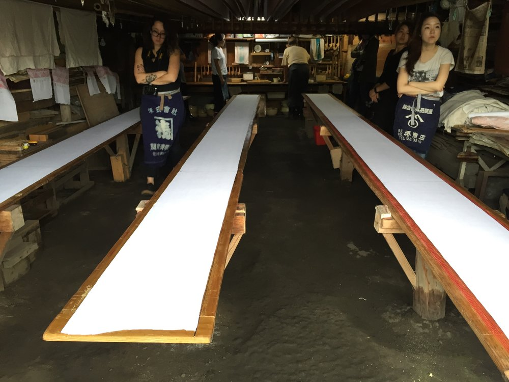 Long boards used for printing on Kimono panels before dyeing in indigo