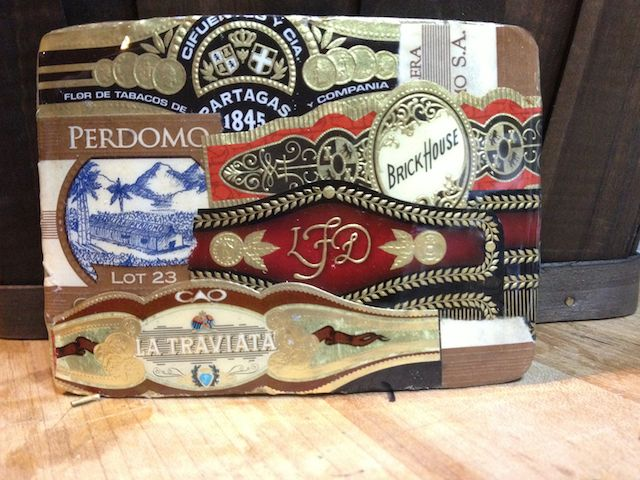 Cigar aficionados are a passionate lot. The wife of one collected the labels from her husband's trash without him knowing. Vintage by Cathy turned them into a belt buckle that he now proudly wears on boys night out.
