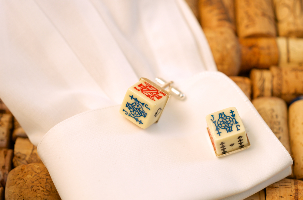 The groom was looking for something unique for his groomsmen. His passions were basketball and poker. Vintage by Cathy sourced these vintage poker dice and turned them into cufflinks. The eight (!) groomsmen loved them. That's a full house!