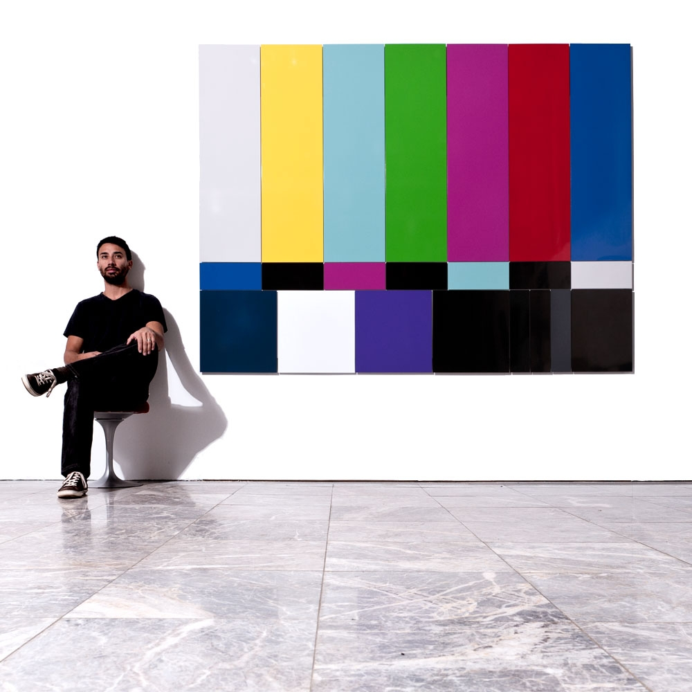 Kristofer Lamey next to his SMPTE  color bars during his 2010 Museum of Design Atlanta (MODA) exhibit.
