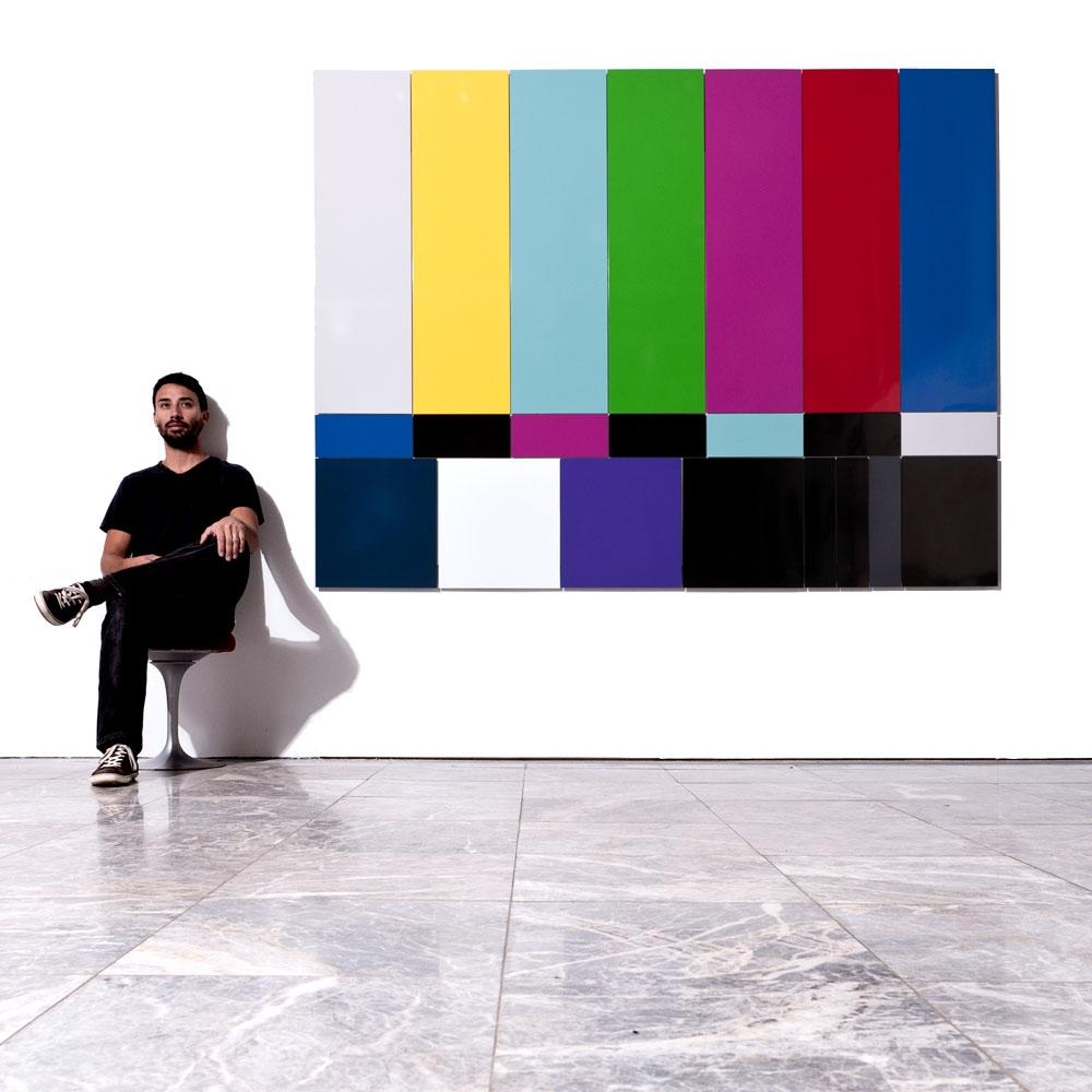 Kristofer Lamey next to his SMPTE color bars during his 2010 Museum of Design Atlanta (MODA) exhibit.