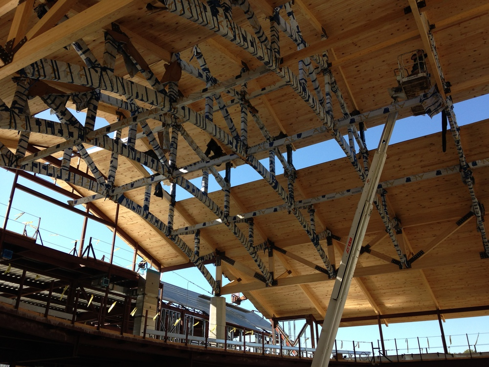 Glulam trusses (still wrapped to protect the finish) and wood roof deck in the Sanctuary.
