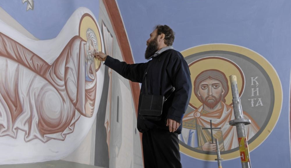 The iconographer Archimandrite (priest-monk) Zenon Theodor painting the walls of St. Nicholas Cathedral, Vienna in 2008.