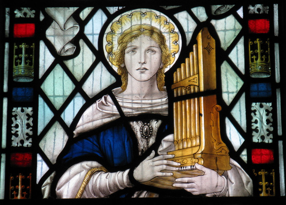 Saint Cecilia in a window in the church of St Mary The Virgin in Little Wymondley in Hertfordshire.