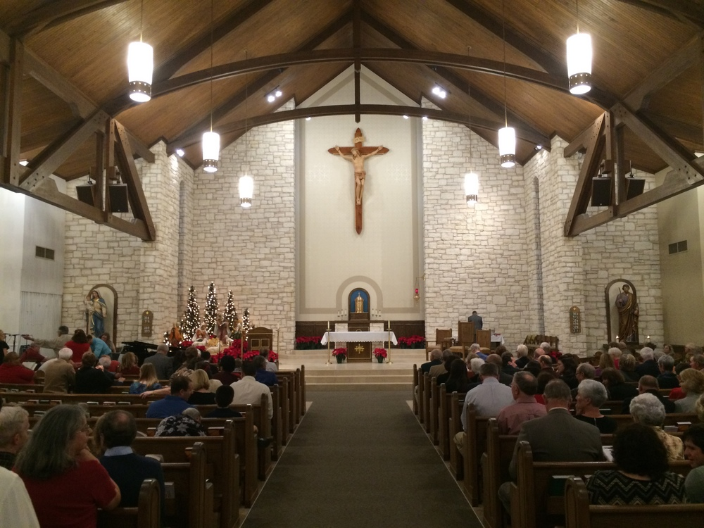 AFTER: A quick snapshot of the renovated sanctuary as crowds gather between Christmas Eve Masses.