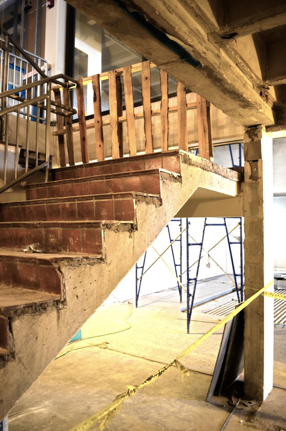 The original lobby stair has been stripped down to its basic forms in preparation for new guardrails and finishes in the basement lobby.