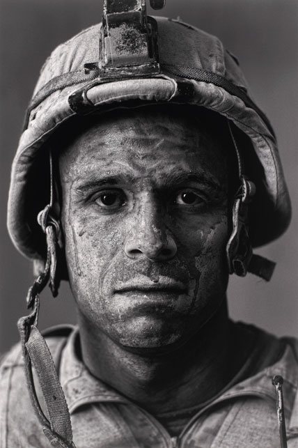"U.S. Marine Gysgt. Carlos ""OJ"" Orjuela, age 31, Garmsir District, Helmland Province, Afghanistan,  from  Project: Home Front, 2008   Louie Palu (Canadian, b. 1968)  © Photographer Louie Palu"