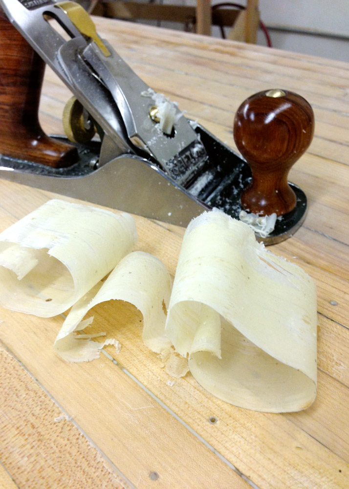 I swapped the sander out for a hand plane, which peeled the ancient lacquer off in thin, white ribbons.