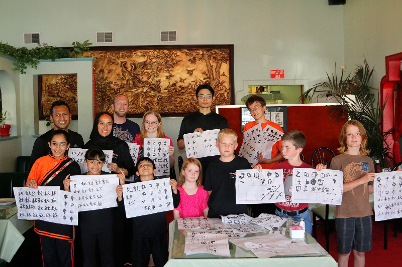 Monk Wise Students practice their calligraphy at the Moon Festival, 2014