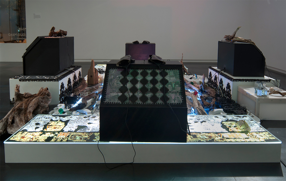 Controller Station (Glove Console) , 2013 30 x 24 x 24 inches, electronics, digital print, laser-cut wood, gloves. Speakers and attached equipment not included.
