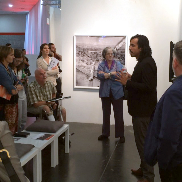 Rodrigo Valenzuela giving a talk to the FotoFest Collector's Circle tour.