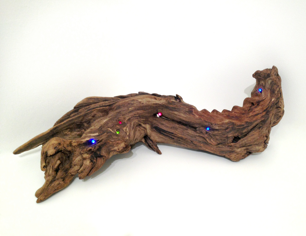 Untitled (LED Driftwood) , 2013 hand-carved driftwood, polyurethane, LEDs, light sensor, 8 x 22 x 8 inches