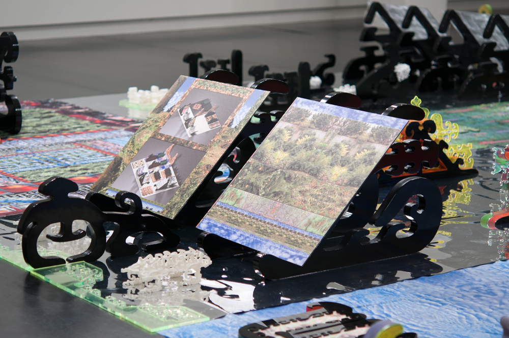 Central~Lattice Tool Array  (detail), showing cradled prints  Embedded Scape  (left) and  Facial Array  (right) by Brenna Murphy