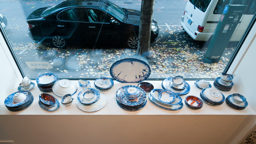 An Embarrassment of Dishes , 2015 blue pigment, 7-Up and simple syrup, painted and kiln fired on a 1961 set of Noritake dishware, service for 12 Technical assistant: Toni Acock.