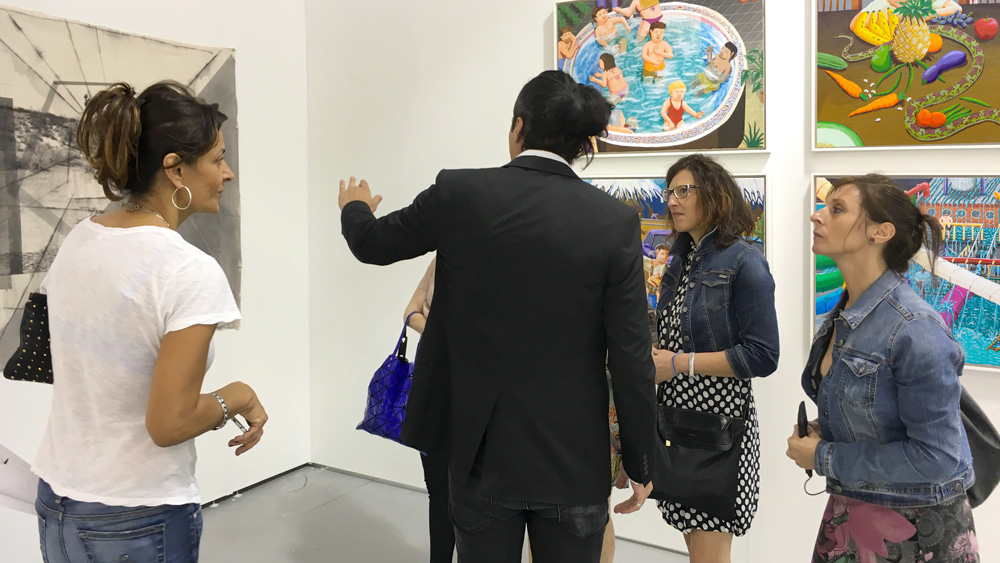 Artist Rodrigo Valenzuela talking about his newest work,  Sense of Place No. 1 , with Fair-goers.