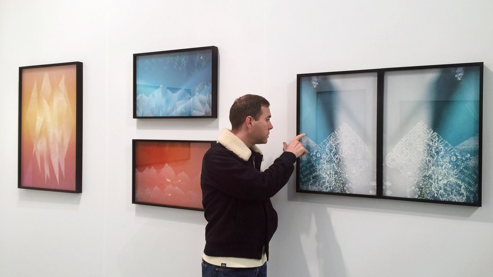 Artist Christopher Russell with his works at AIPAD 2017