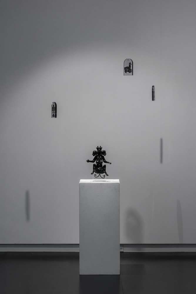 Huma and Talismans , 2016 3D printed black resin sculpture: 12 x 6 x 5 inches; 3D printed clear resin talismans: 3 x 2 x 1 inches (each); edition of 3 plus 2 AP