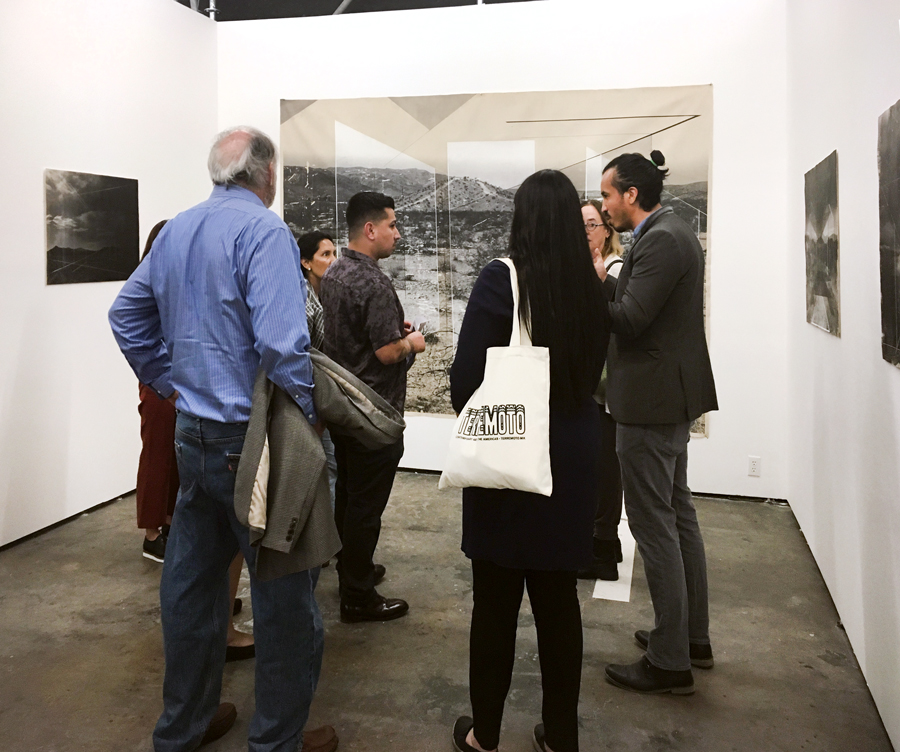 Artist Rodrigo Valenzuela talking with visitors to Upfor's booth at Material.
