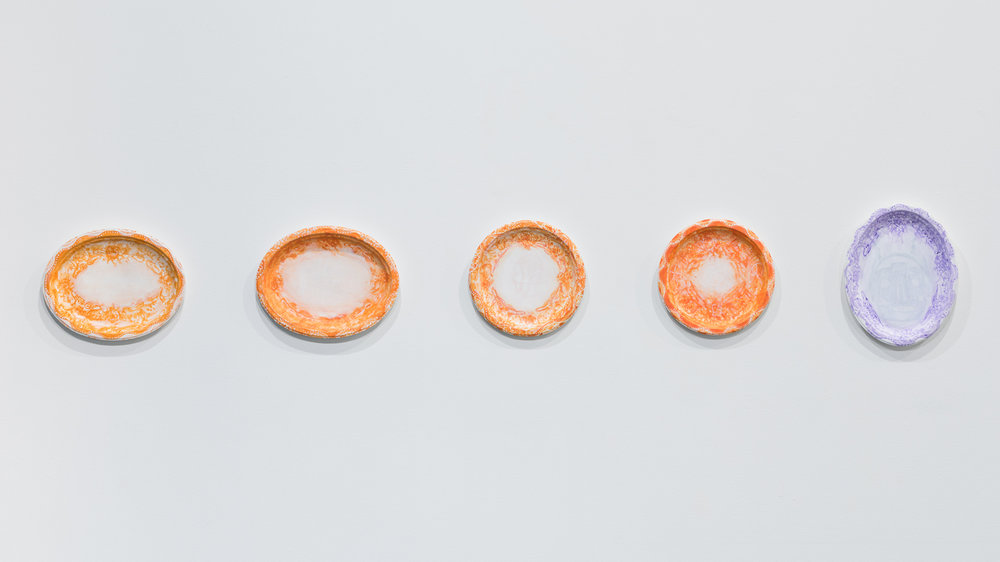 left to right:  Not Blue , 2017;  Waiting For the Other Shoe , 2017;  Gossip Bridle , 2017;  Gossip Bridles , 2017;  Too Sad to Tell You , 2018 each: acrylic and day glow on gessoed Chinet plate or platter