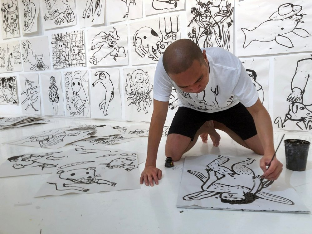 Ralph Pugay creating a series of drawings during his Rauschenberg Residency at Captiva, Florida. Photo by Mark Poucher, courtesy the Robert Rauschenberg Foundation