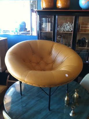 mid-century leather pod chair on metal base