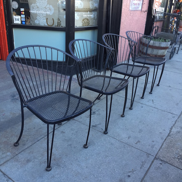 set of four mid-century iron patio chairs