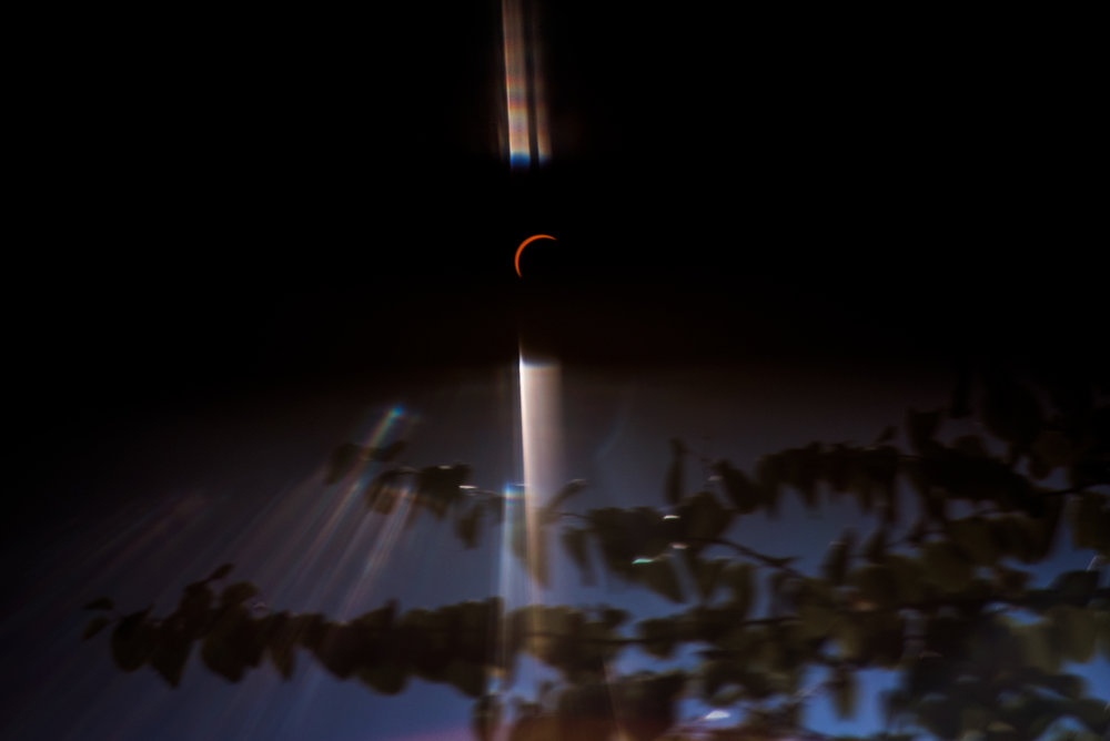 eclipse shot through solar glasses | amy selleck photography | amyselleck.com