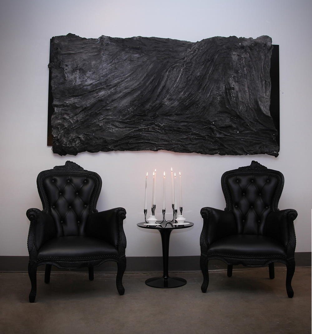 Soot featured with two Moooi Smoke Chairs by Maarten Baas.