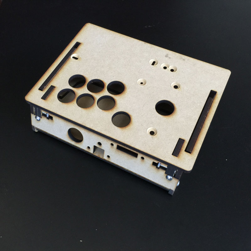 The back panel hosts the programming button and switch for easily loading and saving button presets. We can custom design frame with any inputs for you here:  GameThing Shop