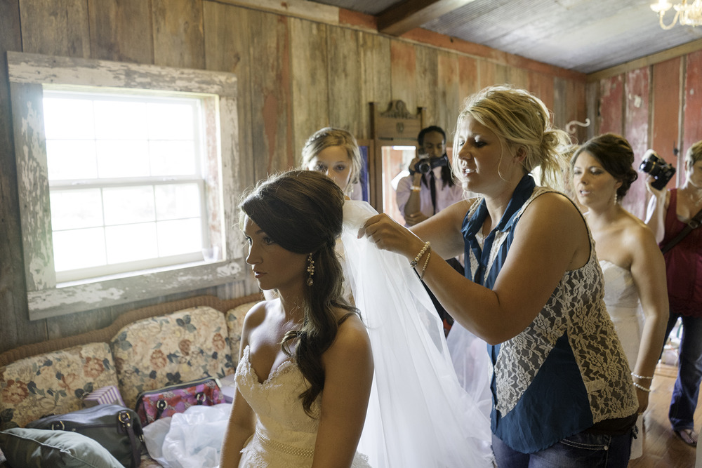 The veil being placed on the bride featured embroidery from her mother's wedding dress