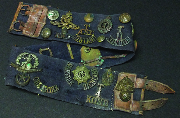 Frank's army issue belt decorated with badges, buttons and shoulder titles. It was common for soldiers to exchange badges.