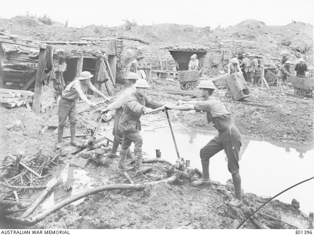 Members of the 1st Australian Tunnelling Company excavating at Hooge, in the Ypres Sector. Work on these dugouts constituted a record for Tunnelling Companies employed under such conditions, for the ground, in close proximity to the famous Hooge Crater, was a shell churned marsh and soakage was heavy. Accommodation was dug for two Brigades and Headquarters of one Machine Gun Company. Commenced on 5 June 1917, the task was completed and dugouts handed over to the 2nd and 3rd Infantry Brigades on 19 September, for the use of the troops engaged in the operation of the following day. Belgium: Western Front (Belgium), Menin Road Area, Hooge. September 1917.