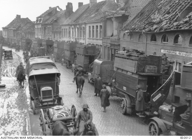 Busses conveying the 2nd Division to the Ypres sector passing through the town, along Herberg Street. Belgium: Flanders, West-Vlaanderen, Vlamertinghe. 26 October 1917.