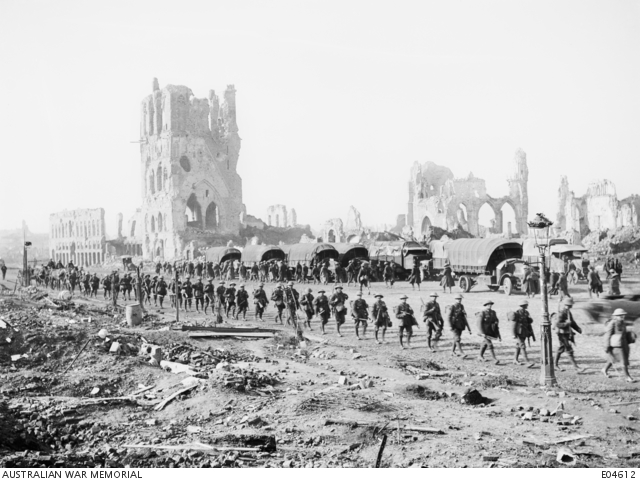 Ypres Sector, Belgium. 25 October 1917. Australians on the way to take up a front line position in the Ypres Sector. The ruins of Ypres, including the Cloth Hall, can be seen in the background. 25 October 1917.