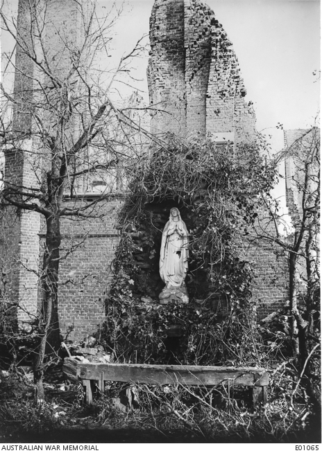 View of a shrine near a demolished church at Ypres. Though the surrounding buildings were almost obliterated this shrine, remakably enough, was not damaged. Belgium: Western Front (Belgium), Ypres Area, Ypres. 2 November 1917.