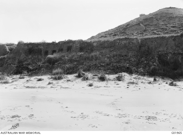 View of our Australian positions (left) on Gaba Tepe. Note the protective holes dug into the cliff at left. One of a series of photographs taken on the Gallipoli Peninsula under the direction of Captain C E W Bean of the Australian Historical Mission, during the months of February and March, 1919.
