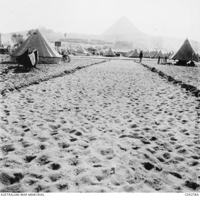The ancient pyramids of Egypt form a backdrop to the tent city of the 1st Australian Division's camp at Mena outside Cairo. The division had left Australia in November 1914 for the war in Europe but was diverted to Egypt, where it underwent months of training and was formed into the ANZAC Corps. Bound for the war On 4 August 1914 Great Britain declared war on Germany, and Australia was immediately committed. The nation quickly set about raising a special volunteer army, called the Australian Imperial Force. Charles Ryan was by then 60 years old and a colonel in the Australian Army Medical Corps. He was quick to offer his services and was appointed Assistant Director of AIF Medical Services. He sailed from Melbourne with the headquarters of the 1st Australian Division on the troopship Orvieto on 22 October 1914. The Australians thought they were destined for Europe. Instead, while at sea, they received the news that Turkey had entered the war on the side of Germany and that the force would disembark in Egypt. Ryan was in a familiar part of the world, but now his enemy was the very army for which he had once served. The Australians settled into camp in the shadow of the pyramids and began their training.  With the New Zealanders, they were formed into the Australian and New Zealand Army Corps (ANZAC) under the command of a British general, Sir William Birdwood.