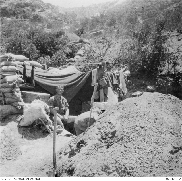 "Unable to advance further during the landing in April, the Anzacs were ordered, in the words of the British commander, General Sir Ian Hamilton, to ""dig, dig, dig, until you are safe"". Here a soldier has excavated a hole for a dug-out in the slopes above the beach and reinforced it with sandbags."