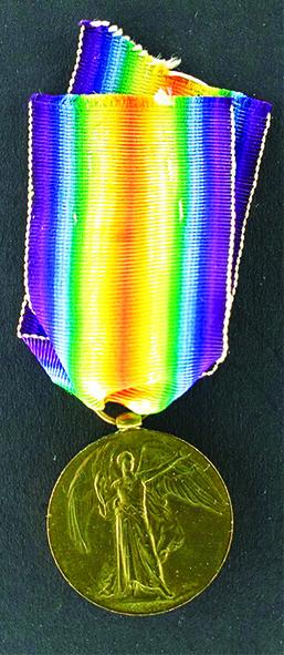 Eric Medal purple yellow side 1.jpg