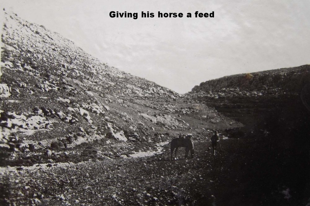 Giving his horse a feed C.jpg