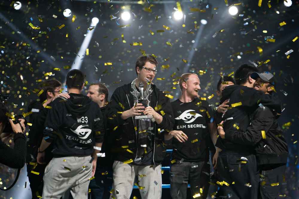 Team Secret and their price after winning against  Team Liquid ( Tim Franco for ESPN )