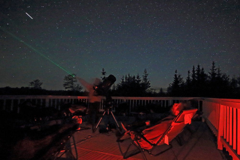 Visitors watch the Iss as it passes overhead, while tim provides a laser-guided sky tour. (Brenda Tate)